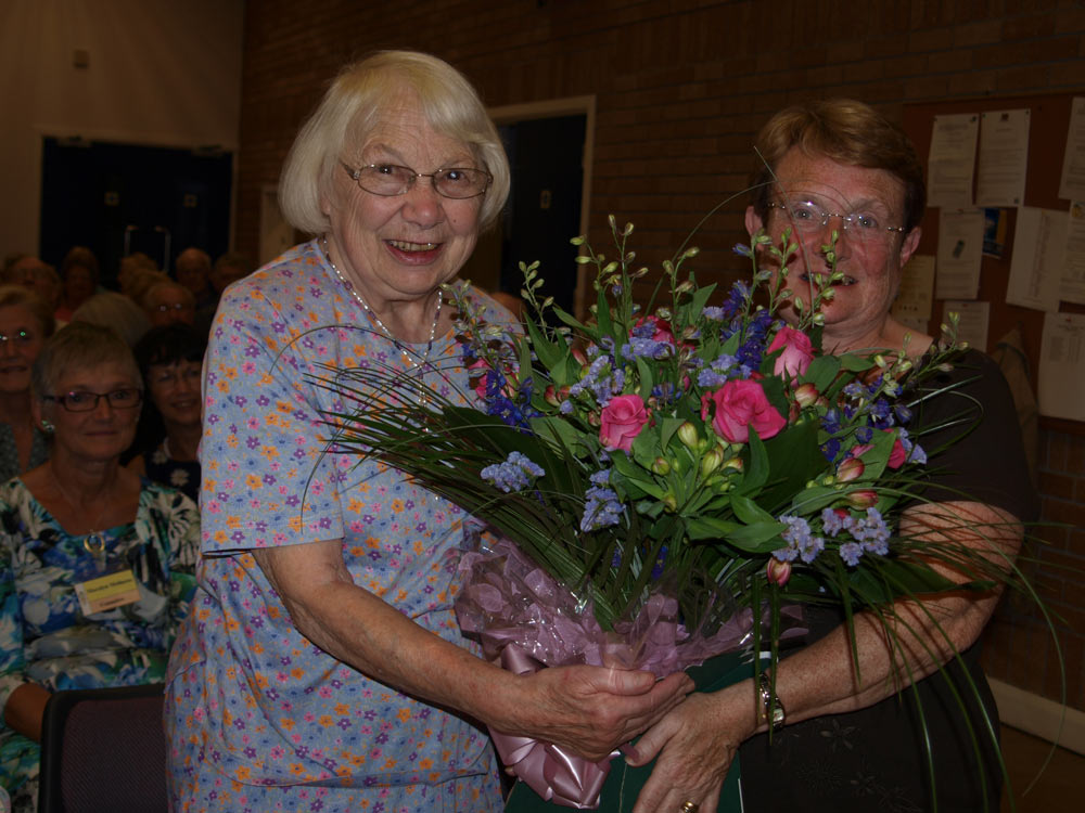 Lynne presents flowers to Betty